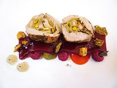 An alternate serving of Raspberry, Goat's Milk, Red Pepper Taffy, Pistachio from the Alinea Restaurant cookbook. Lavender salt encrusted pork tenderloin, stuffed with pistachios. Served with fresh raspberries, bell pepper taffy, pistachio purée and lavender pudding. Topped with a raspberry sheet, pistachio chips, pistachio brittle and fresh lavender flowers.