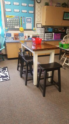 Tall table for kids who like to work standing. Also has stools.