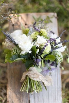 Bridal bouquet- as is for Jennifer (more lavender) wrapped in mom's bridal gown sleeve with pearl pins.   Felicia:  slightly more cascading with greenery