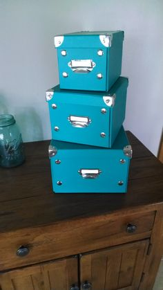 Store all your stuff in these 3 lidded boxes.  Super cute!!