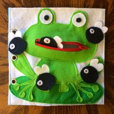 This hungry frog is a single quiet book page to add to your very own custom quiet book. Unzip the hungry frogs mouth and feed him flies! Cute game for little ones to practice counting to five! Quiet Books are a fantastic way to keep your child busy while traveling, at a doctor appointment, during church, or anywhere that you need your little one quietly entertained! Each page offers different ways to play and learn. This quiet book is unique because it is totally customizable, and can…