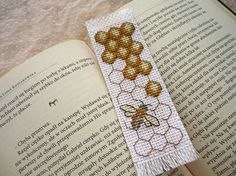 Cross stitch bookmark - bee, embroidered bookmark, gift for readers, book lover Do you need something to mark a page in your favorite book? This unique bookmark is perfect for you! It will be also a luxury gift for the person who loves to read books, talk about them and write. This bookmark is cross stitched with embroidery floss on canvas Aida 14ct, on the back is sutured orange felt. Dimensions bookmark 13cm(5,12) length and 4cm(1,57) width. Bookmark which you order will be carefully…