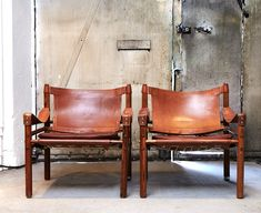 Leather chairs...can be lounge chairs if you choose to have a lounge area. Reminds me of baseball gloves.