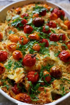 This unusual hybrid of a sweet crumb topping, softly bursting cherry tomatoes and sauced fennel filling originally came together as little more than an experiment.