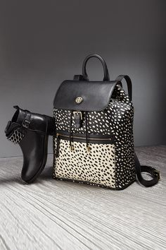 Pack away your laptop and books in Tory Burch's stylishly spotted 'Kerrington' Backpack.