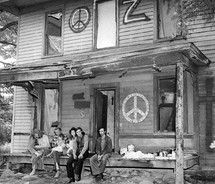 the hippies took over an area of Houston called the Montrose.  Old house such as the one shown that had been big and beautiful but fallen into disrepair were rented by the hippies and furnished with candles (chianti bottle) and a mattress on the floor.