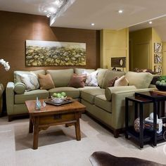 If your basement suffers from cold, dark and creepy, there's a cure: a good dose of light, warm and cozy. Light comes into play with recessed lights, track lighting and beautiful accent lights. Coziness comes from color: warm muted colors alike butterscotch, copper and sage.  Check out my book FAMILY SPACES for more on basement renovations