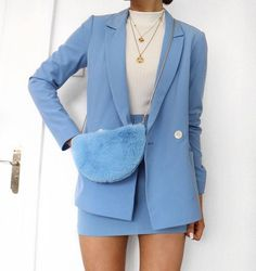 Blogger Lissy Roddy in our blue double breasted blazer and matching skirt