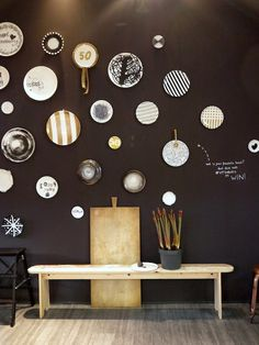 Woonbeurs 2014 Creative wall treatment, love nice plates on walls & black can really set them  off!