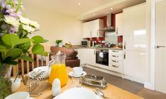 Welcome to Cragholme in Bowness. Book your holiday in the Lakes online with Lakelovers today. Luxury Apartments, Lakes, Kitchen Cabinets, Cottage, Table, Furniture, Dog, Holiday, Home Decor