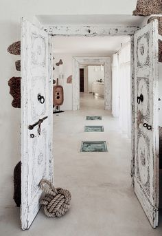 Home in Sardinia: White concrete floors distressed, white washed doors, with vintage pull-ring handles bolt lock / Méchant Design Coastal Style, Coastal Living, Coastal Decor, Modern Coastal, Coastal Cottage, Coastal Industrial, Coastal Entryway, Coastal Interior, Coastal Rugs