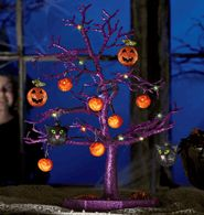 """Sparkling Halloween Tree  Avon exclusive. Get Halloween glowing with our tricked out tree! This creepy centerpiece features 12 hanging ornaments and 12 LED lights. Ornaments include: 8 pumpkins, 2 spiders and 2 cats. Uses 3 AA batteries (not included). Collapses for easy storage. On/off switch. 14 1/2"""" W x 17"""" H. Base, 8"""" diam. Plastic. Imported"""