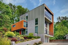 This modern four-storey single family 'tower' house designed by Spore Design is situated on a small odd shaped lot in Seattle, Washington.