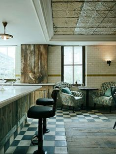 Soho_house_toronto_01/ The designers artfully preserved remnants of the original space: a new ceiling frames old tin tiles, and on the floor, black and white tiles meet up with the existing floorboards
