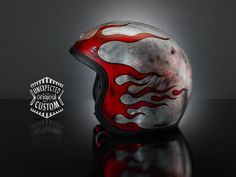 """Simple but aggressive helmet design. Covered in silver leaf and worked with a special technique that simulates the effect of the old rusty iron sheet. The flames are made with glass paints and reveal the """"grunge"""" effect of the ruined metal."""