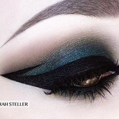 Shimmering blue- achieve this look with Make-Up Designory's eye color in smoked sapphire with onyx, and the black cake liner.