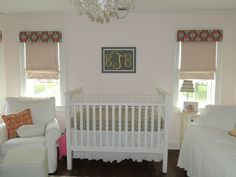 Simple crib, artwork and window shades