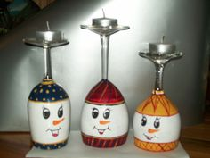 snowman candle holders made from upside down wine glasses.