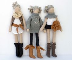 Handmade fabric doll in her denim boots, soft touch waistcoat and faux suede belt.
