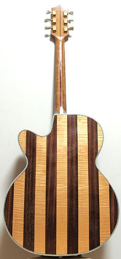 Vintage German Huttl archtop guitar, model Opus. Striped guitar back in mahogany and flamed maple.