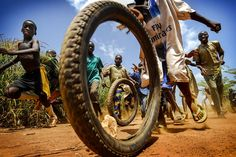 Children play with tires outside a medical center in the West African nation of Togo. Antonio Aragon RenuncioPHOTOS: Prize-Winning Images Capture The Beauty Of Daily Life Around The Globe : Goats and Soda : NPR