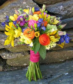 Colorful Hand Tied Wedding Bouquet: Blue Delphinium, Yellow Freesia, Pink Freesia, Orange Ranunculus, Red-Orange Ranunculus