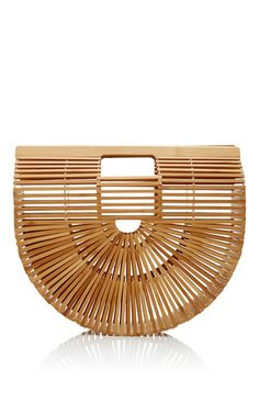 This **Cult Gaia** large ark clutch is rendered in bamboo with inspiration from the Japanese picnic bag and features a carved logo detailing on the interior handles, a curved base and open top.