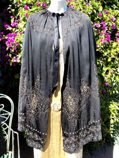 C 1890 Metallic embroidered black cape. This is from the Victorian era . It is beautifully done with various shades of metallic bronze and gold metal