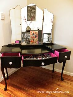 Love this vanity with bits of pink on it.