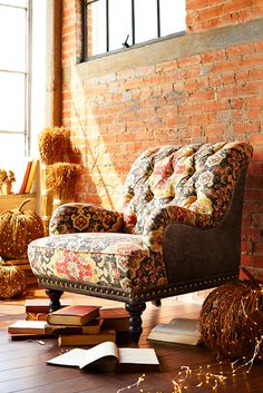 Pier 1's overstuffed Chas Armchair looks and feels like it came straight from an English manor. Carved hardwood legs, button-tufted upholstery and nailhead trim make it a classic--all without squandering the inheritance.
