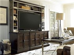 www.chapinfurniture.com Console with Deck featuring adjustable shelving, optional glass or wood panel inserts for cabinet doors and power outlet!