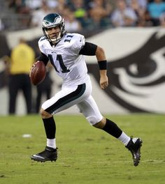 Eagles' quarterback Trent Edwards scrambles with the football against the New York Jets during the second quarter in a preseason game on Thursday, August 30, 2012. ( Yong Kim / Staff Photographer )