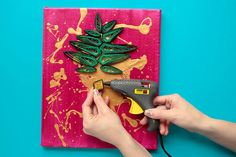 Folded Up Pieces Of Paper And Splattered Paint Make For Beautiful Wall Art! - http://www.wisediy.com/folded-up-pieces-of-paper-and-splattered-paint-make-for-beautiful-wall-art/