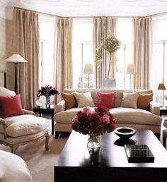 Amazing 15 Inspiring Beige Living Room Designs : Modern Brown And White Beige Living Room With Sofa Red Pillows Black Table Flower Lamp Gordyn And Big Window Design