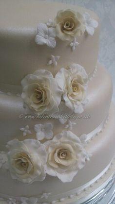 Cascading Ivory sugar flower roses for a wedding cake. Visit my page www.helenthecakelady.co.uk