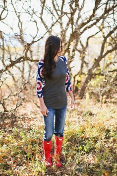 This Randy baseball tee by Lularoe is so soft and perfect for spring. It's long enough to wear with leggings, jeans, or a skirt. You will want to live in this super soft style. Love it paired with red hunter boots.