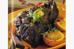 Bobby Flay makes a roast pork that celebrates the flavours of Cuba.