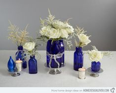 white flowers centerpiece blue glass