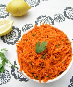 Fresh shredded carrots are tossed with a light dressing of olive oil, lemon juice, cumin and garlic in this festive Moroccan Raw Carrot Salad.