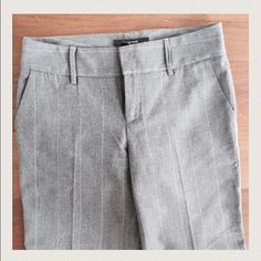 """Zara Grey Wide Leg Pants Grey with thin white stripes, these pants are amazing! Cuffed at the bottom, two side pockets and one pocket in the back. Inseam is about a 34"""". I'm 5'9"""" and can wear heels with these. Excellent condition and so chic for work! Zara Pants Trousers"""