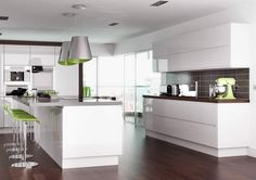 Kitchen idea - Love the white gloss handleless cupboards with the warmth of brown and lime colour splash.