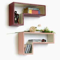 Trista - [Cardinal Red] Gun-Shaped Wall Shelf / Bookshelf / Floating Shelf (Set of 2) by Trista Wall Shelf. $63.99. Create stunning storage solution while saving space.. Constructed from sturdy MDF materials. Wipe clean with a dry cloth.. A handsome addition to any wall decor.. Top faux leather covering with contrast stitching over a sturdy wooden frame.. Display souvenirs, photos, CDs, awards, books, decorative items and more.. These beautifully crafted L Shaped Wall She...