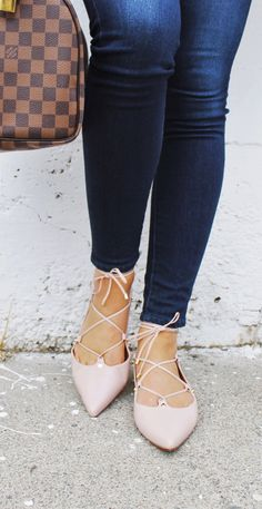 Blush pink lace up ballet flats with a pointy toe
