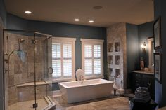 Wall color in the bathroom looks great with the white and stone; also like the built-in cubby spaces within the brick stone wall