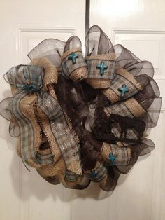 Western Cross and Cowboy Everyday Deco Mesh Wreath in Turquoise, Brown, and Burlap.. $50.00, via Etsy.