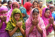 Family members of missing garment workers offer prayers in front of the rubble on May 14. One day earlier, the Bangladeshi Army announced that no more bodies remained in the rubble and officially ended the search.