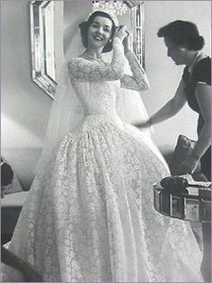 "Lovely dress from 1950s, when brides looked ""bridal"".  Since when did sleeved become a bad thing for brides?"
