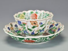 A Chinese Famille Verte Porcelain Cup and Saucer, 18th century, Kangxi period…