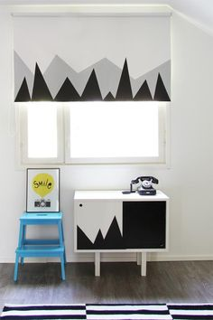 How to dress up a plain roller shade with a little black and gray paint. #DIY