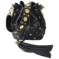 Custom poppy Lissiman roman style coins along shoulder strap and down side panels carefully mixed with gun metal silver stars studs in various sizes. - Bucket bag has drawstring opening with two large